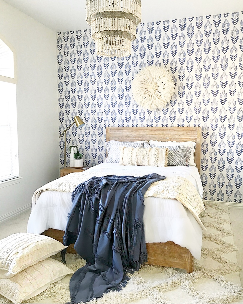 bedroom with wallpaper
